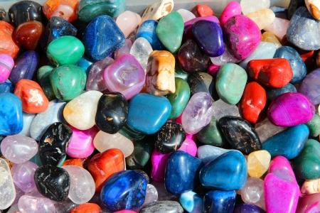 black onyx: Colorful gemstones on sale at a flea market in Sibiu, Romania. Multicolored background.