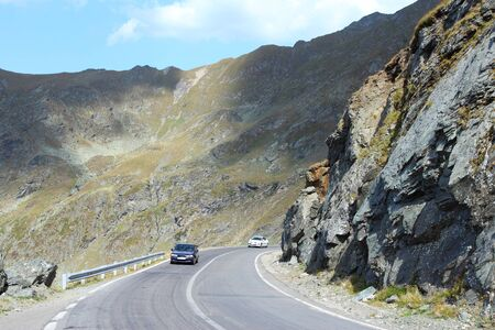 Romania - Fagaras Mountains in Transilvania. Famous Transfagarasan mountain winding road. photo