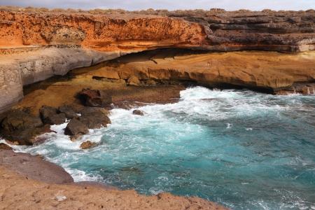 adeje: Tenerife, Canary Islands, Spain - beautiful sandstone bay at El Puertito. Part of Costa Adeje coast.