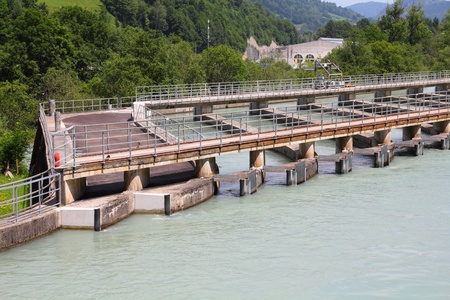 weir: Hydro power plant on Salzach river near Zell Am See, Austria  Concrete weir  Stock Photo