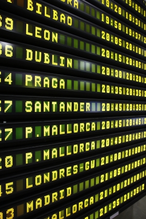 Departure schedule at an airport in Spain. Flights to Bilbao, Leon, Dublin, Prague, Santander, Mallorca, London and Madrid. photo