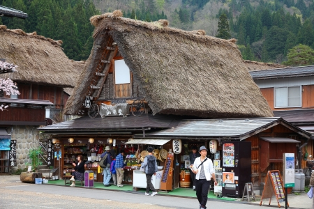 SHIRAKAWA, JAPAN - APRIL 28: Tourists visit old village on April 28, 2012 in Shirakawa-go, Japan. Shirakawa-go is one of most popular attractions in Japan, listed as UNESCO World Heritage Site since 1995.