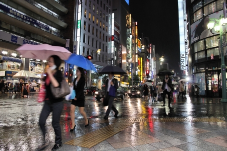 TOKYO - MAY 9: People shop in rain on May 9, 2012 in Shinjuku district, Tokyo. Shinjuku is one of the busiest districts of Tokyo, with many international corporate headquarters located here. Stock Photo - 16919934