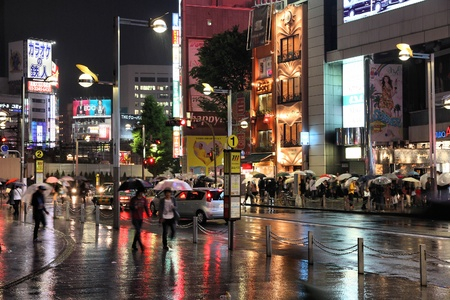 TOKYO - MAY 9: People shop in rain on May 9, 2012 in Shinjuku district, Tokyo. Shinjuku is one of the busiest districts of Tokyo, with many international corporate headquarters located here. Stock Photo - 16919932
