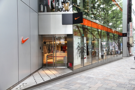 TOKYO - MAY 9: Shoppers visit Nike store on May 9, 2012 in Omotesando, Tokyo. Nike is one of most recognized fashion brands. It exists since 1964 and had US$ 19 billion revenue (2010). Stock Photo - 16919924