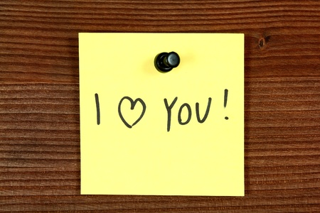Sticky note with love message - I love you. Bulletin board. Stock Photo - 17132015
