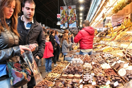 BARCELONA, SPAIN - NOVEMBER 6: People visit Boqueria market on November 6, 2012 in Barcelona, Spain. Tripadvisor says it is best shopping destination in Barcelona, the most visited city in Spain. Stock Photo - 17146508