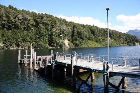 New Zealand - pier at Lake Manapouri in Southland and Fiordland region. photo
