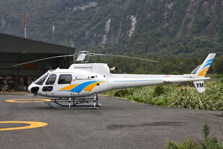 heli: MILFORD SOUND, NEW ZEALAND - FEBRUARY 26: Eurocopter AS350 parked on February 26, 2008 in Milford Sound, New Zealand. AS350 is on of most successful helicopters ever (5000+ produced).
