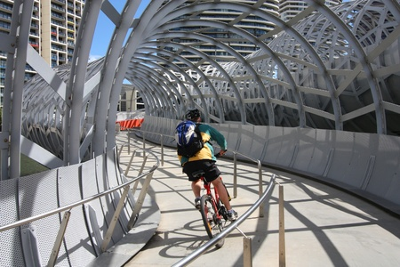webb: MELBOURNE, AUSTRALIA - FEBRUARY 9: Cyclist rides along Webb Bridge on February 9, 2008 in Melbourne, Australia. Webb Bridge was designed by D.C. Marshall and received many awards.