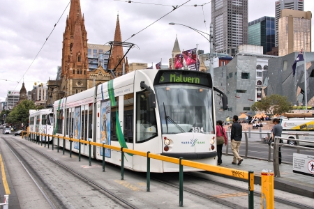 tram: MELBOURNE, AUSTRALIA - FEBRUARY 9: People board Yarra Tram on February 9, 2008 in Melbourne, Australia. Yarra Trams served 158 million rides in 2008. Siemens Combino tram. Editorial