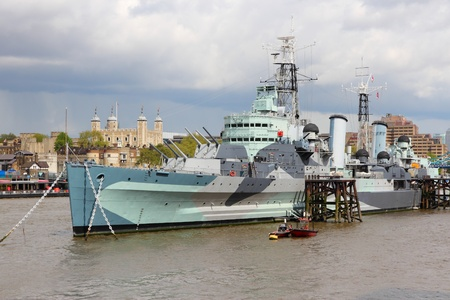 hms: London, England - famous historic ship, HMS Belfast. Light cruiser navy vessel moored in Thames River. Editorial