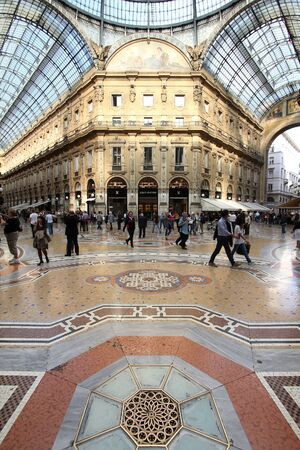MILAN - OCTOBER 6: People visit Vittorio Emmanuele II shopping gallery on October 6, 2010 in Milan, Italy. Inaugurated in 1865, the gallery claims to be the oldest shopping center worldwide. Stock Photo - 17378332
