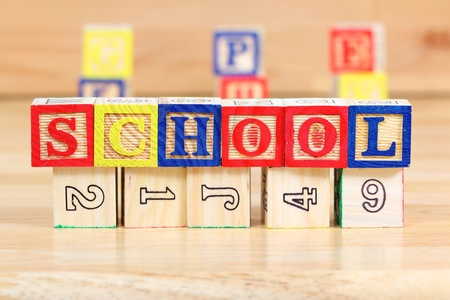 Wooden blocks with letters. Children educational toy concept - the word school. Stock Photo - 17480573