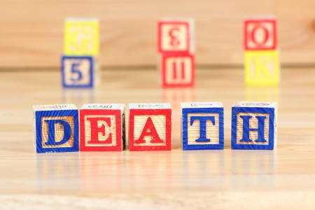 Wooden blocks with letters. Educational toy concept - children learning about death. Stock Photo - 17480567