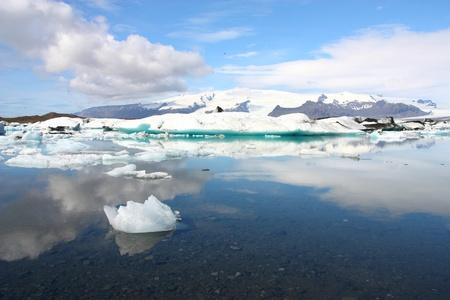 jokulsarlon: Iceberg on Jokulsarlon lagoon in Iceland. Famous lake. Travel destination for tourists next to Vatnajokull glacier.