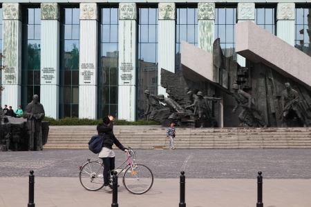insurgents: WARSAW, POLAND - SEPTEMBER 9: Cyclist rides by Insurgents Monument on September 9, 2010 in Warsaw, Poland. Warsaw is the 13th most visited city in Europe (2007) with almost 3m international visitors.