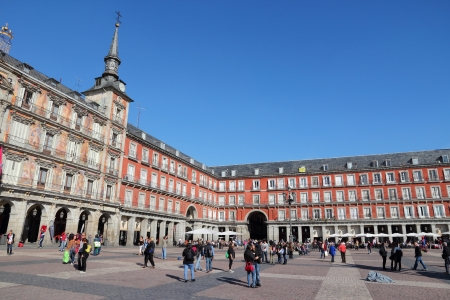 estimated: MADRID - OCTOBER 22: People visit Plaza Mayor square on October 22, 2012 in Madrid. Madrid is a popular tourism destinations with 3.9 million estimated annual visitors (official data).