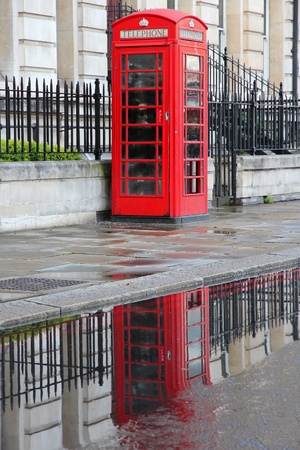 London, United Kingdom - red telephone box in the rain photo