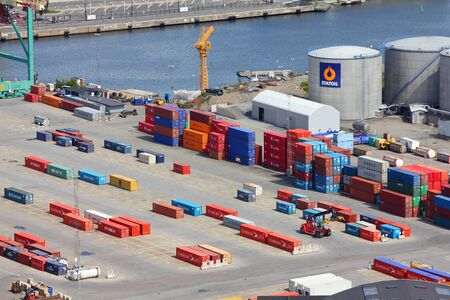 STOCKHOLM - MAY 31: Containers are being loaded on May 31, 2010 in Stockholm Port. In 2011 Stockholm Port handled 6,496,000 metric tons of goods and 27,843 containers. Stock Photo - 17522831