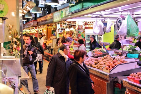BARCELONA, SPAIN - NOVEMBER 6: People visit Boqueria market on November 6, 2012 in Barcelona, Spain. Tripadvisor says it is best shopping destination in Barcelona, the most visited city in Spain. Stock Photo - 17522849