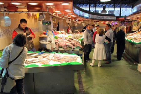 BARCELONA, SPAIN - NOVEMBER 6: People visit Boqueria market on November 6, 2012 in Barcelona, Spain. Tripadvisor says it is best shopping destination in Barcelona, the most visited city in Spain. Stock Photo - 17522817