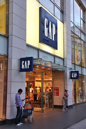 NAGOYA, JAPAN - MAY 3: People visit Gap store on May 3, 2012 in Nagoya, Japan. Fashion retailer Gap exists since 1969, has 3,076 stores worldwide and employs more than 133 thousand people. Stock Photo - 17522819