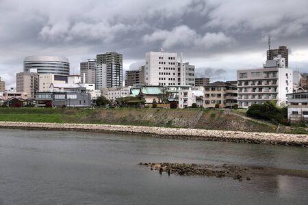 okayama: Okayama city in Chugoku region of Japan (Honshu Island). Modern architecture skyline with Asahi River. Stock Photo