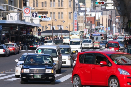 capita: KYOTO, JAPAN - APRIL 17: Taxi driver works in heavy traffic on April 17, 2012 in Kyoto, Japan. With 589 vehicles per capita, Japan is among most motorized countries worldwide, which causes heavy traffic.