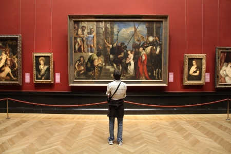 VIENNA - SEPTEMBER 8: Tourist admires art in Museum of Art History on September 8, 2011 in Vienna. With 559k visitors in 2010, the museum is among 100 most visited museums worldwide. Art of Rubens.