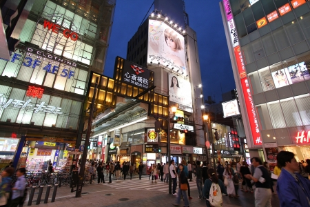 osaka: OSAKA, JAPAN - APRIL 24: Shoppers walk near Shinsaibashi stree on April 24, 2012 in Osaka, Japan. According to Tripadvisor, it is currently among top 10 worth visiting places in Osaka.