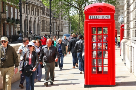 LONDON - MAY 13: People walk past telephone booth on May 13, 2012 in London. With more than 14 million international arrivals in 2009, London is the most visited city in the world (Euromonitor).
