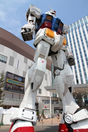 TOKYO - MAY 11: Gundam robot replica on May 11, 2012 in Tokyo. The sculpture is 18m tall and is the tallest replica of famous anime franchise robot, Gundam.