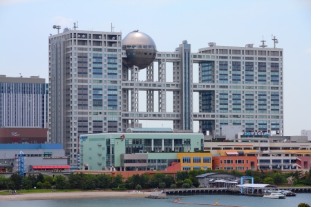 recognized: TOKYO - MAY 11: Fuji TV building on May 11, 2012 in Tokyo. Fuji TV Studios building at Odaiba island was designed by famous Kenzo Tange and is one of most recognized buildings in Japan.