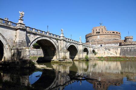 Rome, Italy. View of famous Sant Angelo Bridge and Castle. River Tevere. photo