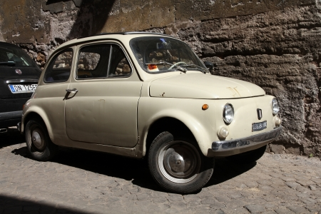 ROME - APRIL 10: Fiat 500 parked on April 10, 2012 in Rome. Fiat 500 was one of the most produced European cars ever with 3,893,294 units manufactured in years 1957-1975.