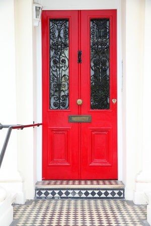 victorian house: London, United Kingdom - typical colorful Victorian architecture door.
