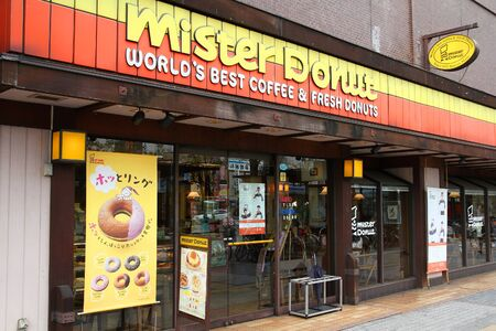 mister: OKAYAMA, JAPAN - APRIL 22: Customers visit Mister Donut cafe on April 22, 2012 in Okayama, Japan. Mister Donut is present in many countries, but Japan is its main market with 1,300 shops.