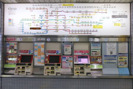 OSAKA, JAPAN - APRIL 25: Network map and ticket machines at Osaka Station on April 25, 2012 in Osaka, Japan. It is the 3rd busiest station in the world serving average 2.4 million passengers daily.