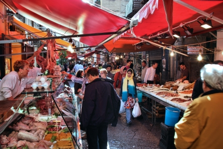 street vendor: PALERMO, ITALY - OCTOBER 25: People shop at local market on October 25, 2009 in Palermo, Italy. Palermo is the 5th most populated area in Italy and the most populated on the island of Sicily.