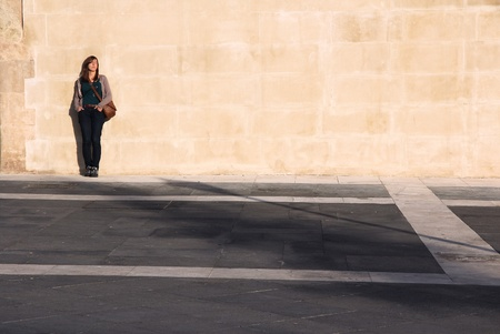 suntanning: Pretty young adult woman enjoys autumn sun in Madrid city, Spain