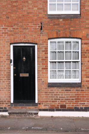 Black door. Warwick town in Warwickshire - West Midlands, England. photo
