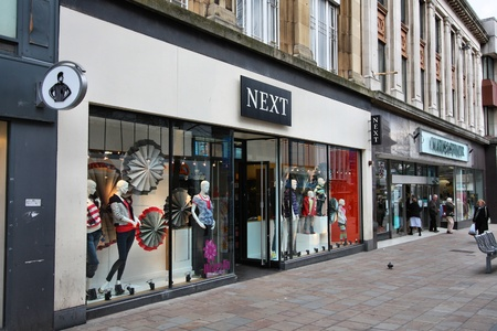 retailer: WOLVERHAMPTON, UK - MARCH 10: People shop at Next and Marks & Spencer stores on March 10, 2010 in Wolverhampton, UK. M&S has 1,010 stores in 40 countries.