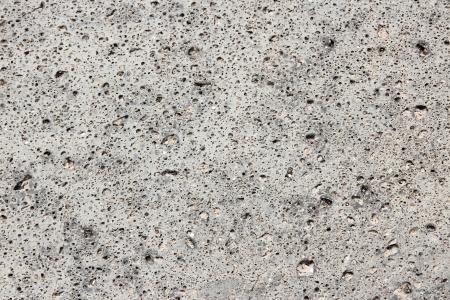 Basalt stone background - vesicular volcanic rock texture