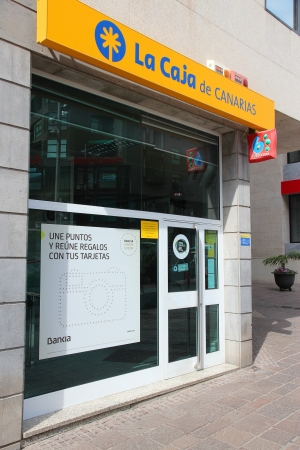 canarias: SANTA CRUZ, SPAIN - OCTOBER 27: La Caja De Canarias bank on October 27, 2012 in Santa Cruz de Tenerife, Spain. The bank exists since 1939 and is part of Bankia group employing 27 thousand people. Editorial