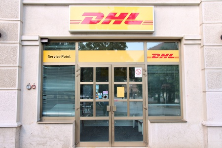 exists: NOVI SAD, SERBIA - AUGUST 14: DHL Service Point on August 14, 2012 in Novi Sad, Serbia. DHL is a world market leader in sea and air mail. It exists since 1969.