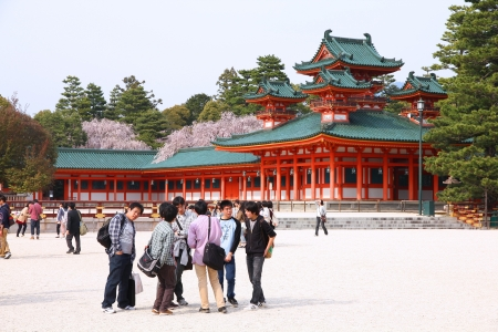 KYOTO, JAPAN - APRIL 19: Tourists visit Heian Jingu shrine on April 19, 2012 in Kyoto, Japan. Old Kyoto is a UNESCO World Heritage site and was visited by almost 1 million foreign tourists in 2010.