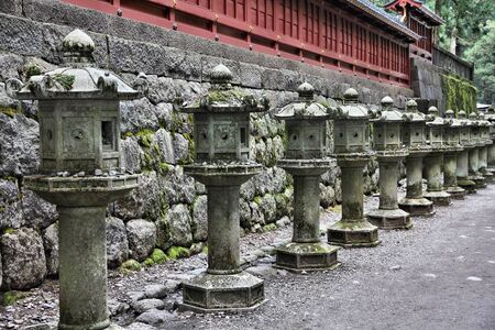 Nikko, Japan -Tosho-gu Shinto shrine, traditional stone lanterns. photo