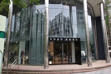 omotesando: TOKYO - MAY 9: People visit Hugo Boss store on May 9, 2012 in Omotesando, Tokyo. Hugo Boss is a German luxury fashion house 263 million EUR operating income in 2010. It exists since 1924.