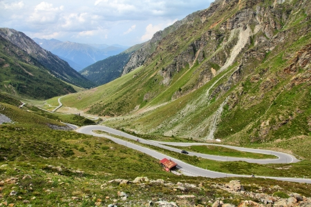 Switzerland. Famous road to Stelvio Pass and Umbrail Pass in Ortler Alps. Alpine landscape. photo